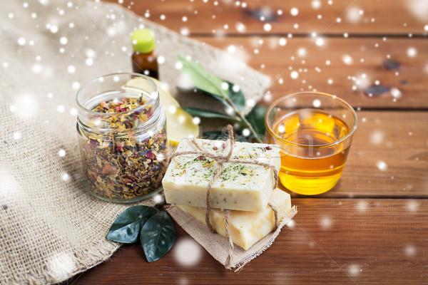handmade soap, honey and herbal tea on wood Stock photo © dolgachov