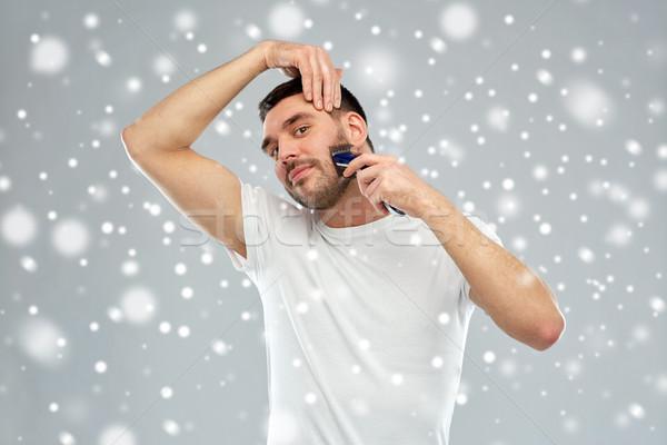 Mosolyog férfi szakáll körülvágó hó szépség Stock fotó © dolgachov
