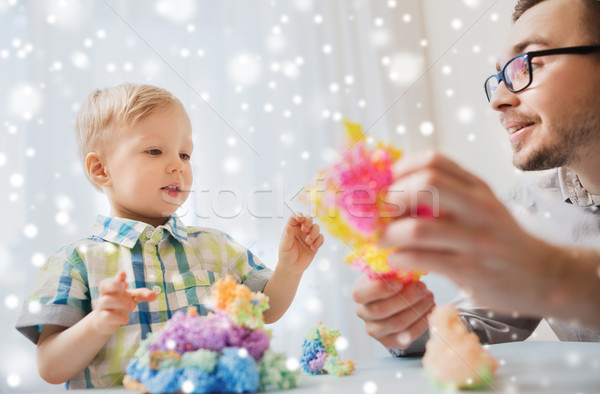 father and son playing with ball clay at home Stock photo © dolgachov