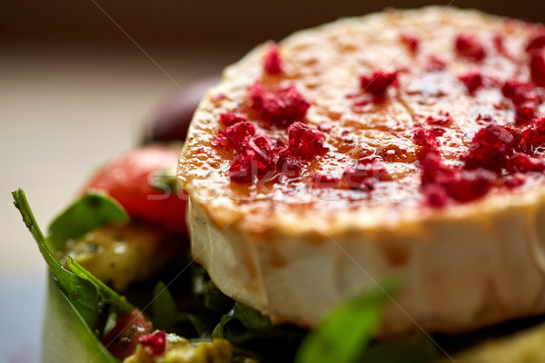 close up of goat cheese salad with vegetables Stock photo © dolgachov