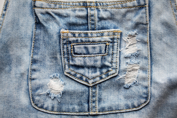 close up of denim clothes or jeans with pocket Stock photo © dolgachov