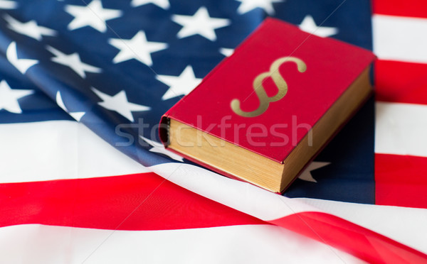 close up of american flag and lawbook Stock photo © dolgachov