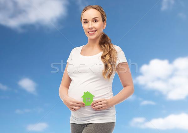 happy pregnant woman with green house Stock photo © dolgachov