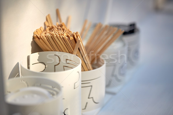wooden drink stirrers in holder on table Stock photo © dolgachov