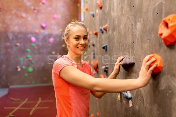 young woman exercising at indoor climbing gym Stock photo © dolgachov