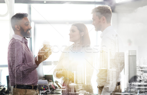 happy business team drinking coffee at office Stock photo © dolgachov