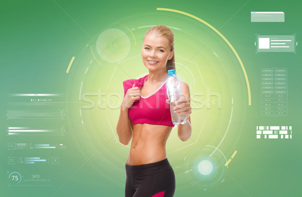 sporty woman with bottle of water and towel Stock photo © dolgachov