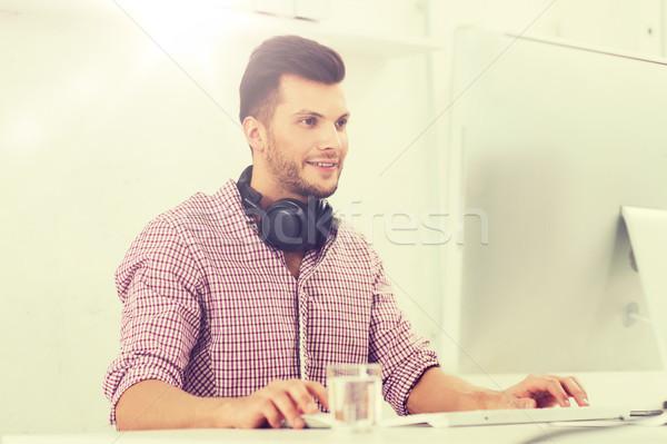 creative man with headphones and computer Stock photo © dolgachov