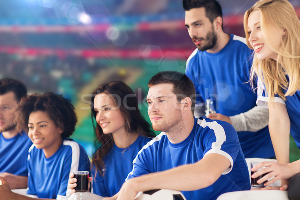 Futebol fãs assistindo futebol combinar estádio Foto stock © dolgachov