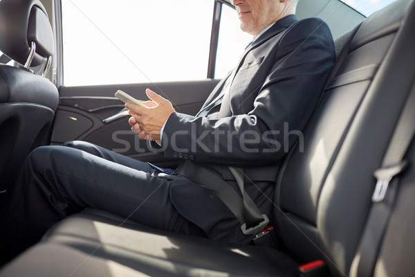 senior businessman texting on smartphone in car Stock photo © dolgachov