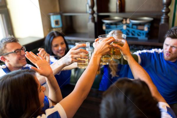 Fútbol aficionados cerveza gafas deporte bar Foto stock © dolgachov