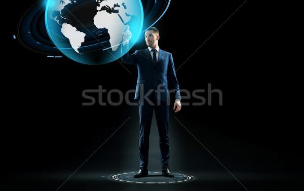 businessman in suit touching earth globe hologram Stock photo © dolgachov