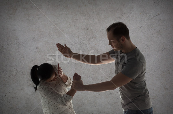 couple having fight and man beating woman Stock photo © dolgachov