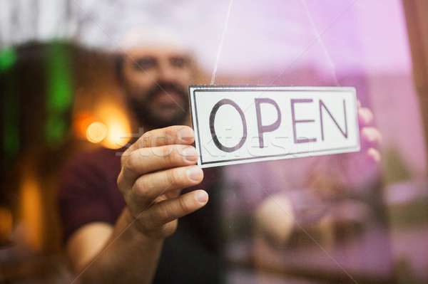 man with open banner at bar or restaurant window Stock photo © dolgachov