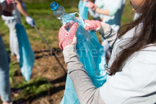 垃圾 袋 瓶 清洗 志願 商業照片 © dolgachov