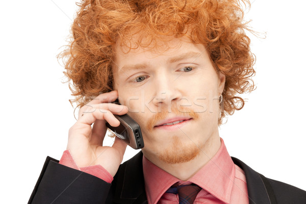 handsome man with cell phone Stock photo © dolgachov