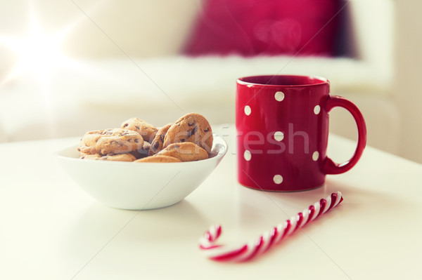 close up of oat cookies, sugar cane candy and cup Stock photo © dolgachov
