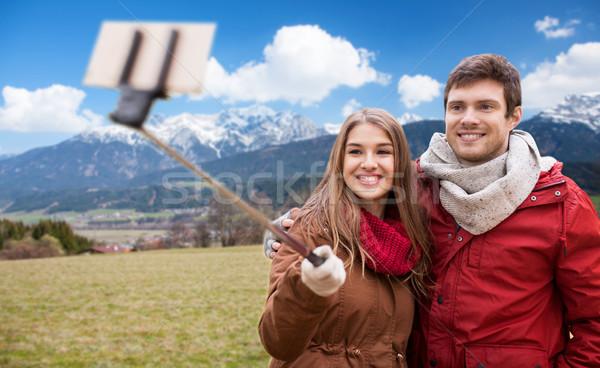 couple taking selfie by smartphone over alps  Stock photo © dolgachov