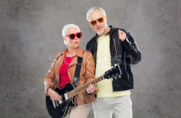 senior couple in sunglasses with electric guitar Stock photo © dolgachov