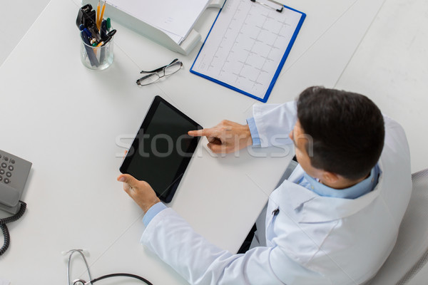 doctor with tablet pc and cardiogram at clinic Stock photo © dolgachov