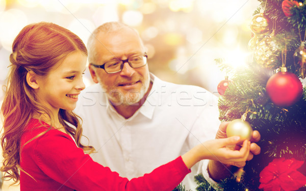 grandfather and granddaughter at christmas tree Stock photo © dolgachov