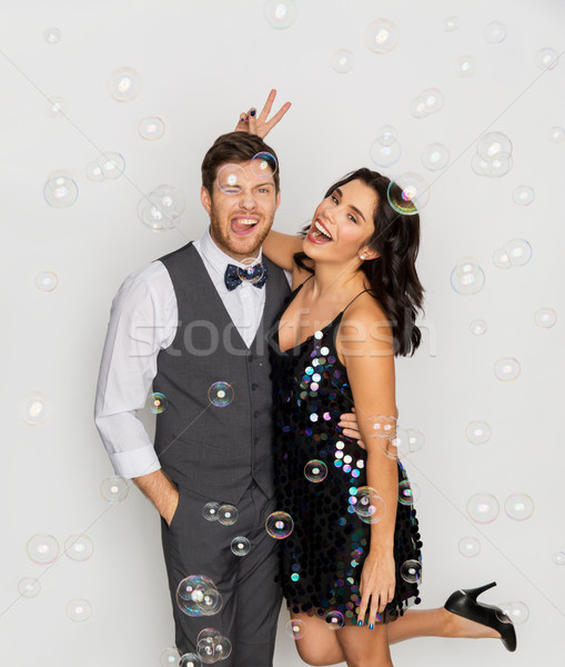 happy couple hugging in soap bubbles at party Stock photo © dolgachov