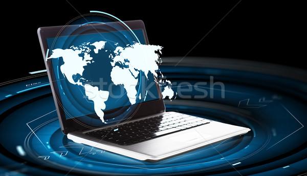 Világtérkép hologram laptop számítógép üzlet jövő technológia Stock fotó © dolgachov