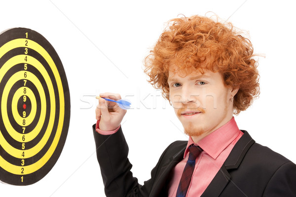 businessman with dart and target Stock photo © dolgachov