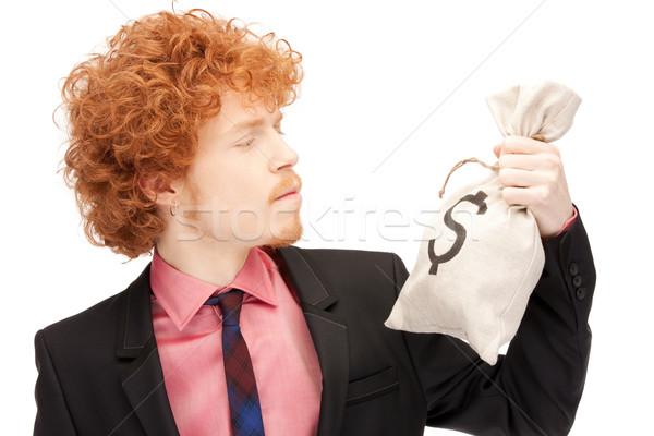 man with dollar signed bag Stock photo © dolgachov