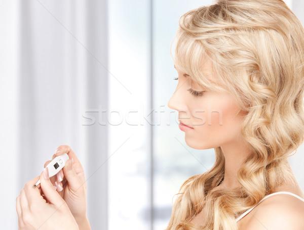 Kadın termometre parlak resim güzel bir kadın kız Stok fotoğraf © dolgachov
