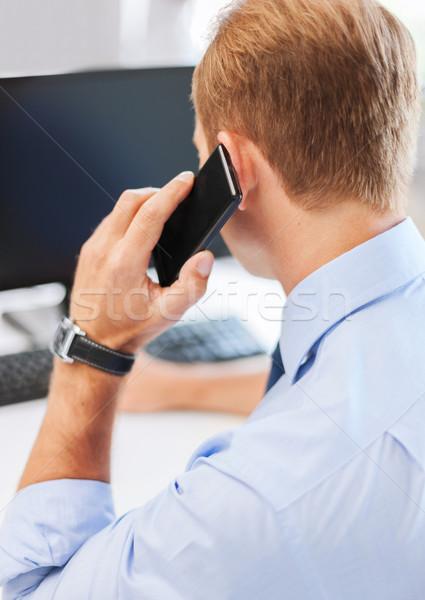 Stock fotó: üzletember · okostelefon · iroda · üzlet · kommunikáció · technológia