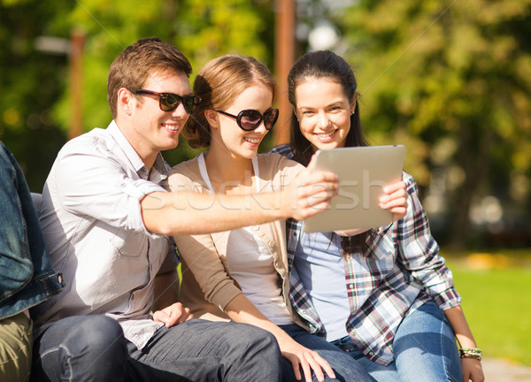 teenagers taking photo outside Stock photo © dolgachov