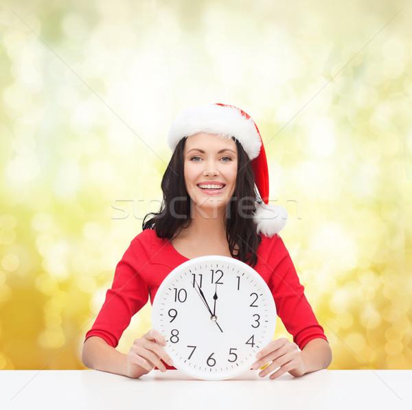 Kadın yardımcı şapka saat Stok fotoğraf © dolgachov