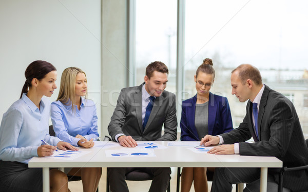 business team with documents having discussion Stock photo © dolgachov