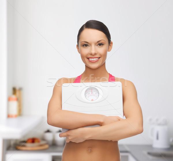Vrouw schaal dieet sport mooie Stockfoto © dolgachov