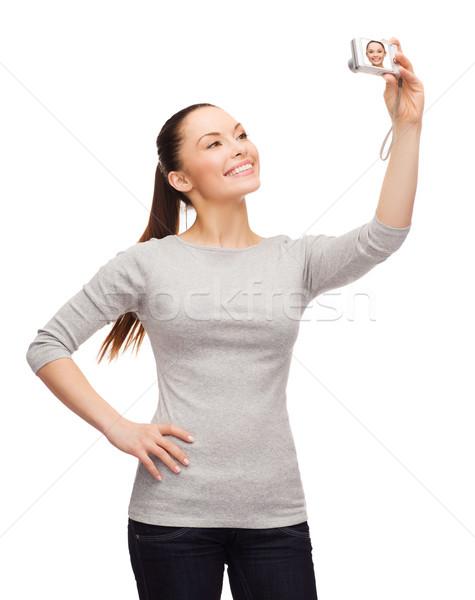 Sorridere asian donna fotocamera digitale felicità tecnologia Foto d'archivio © dolgachov