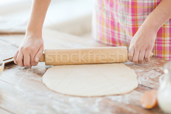 close up of female working with rolling-pin Stock photo © dolgachov