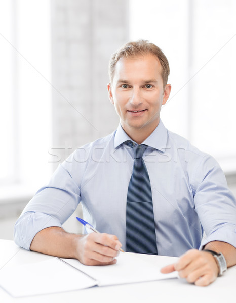 ストックフォト: ハンサム · ビジネスマン · 書く · ノートブック · 画像 · 男