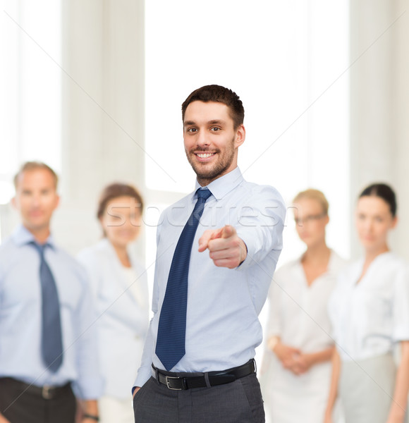 handsome businessman pointing finger at you Stock photo © dolgachov