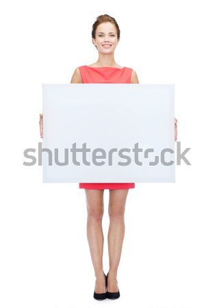 笑顔の女性 セーター ホワイトボード 人 広告 販売 ストックフォト © dolgachov