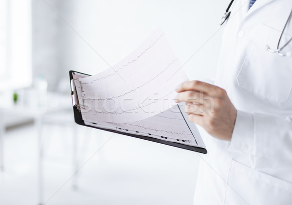male doctor hands holding cardiogram Stock photo © dolgachov