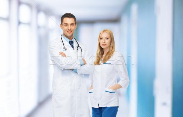 Dois jovem atraente médicos médico facilidade Foto stock © dolgachov