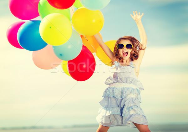 Felice jumping ragazza colorato palloncini estate Foto d'archivio © dolgachov
