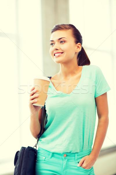 student holding take away coffee cup Stock photo © dolgachov
