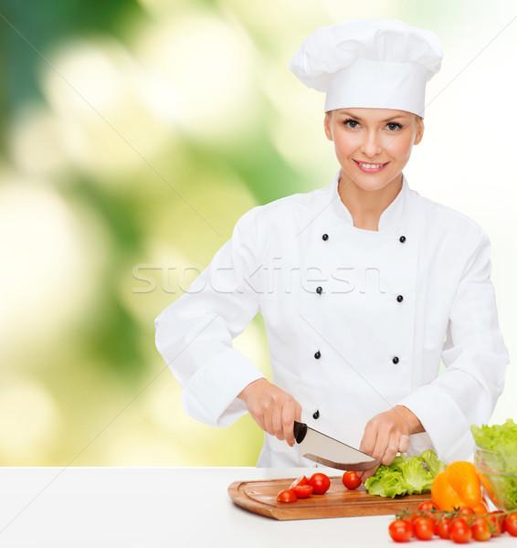 Sonriendo femenino chef hortalizas cocina Foto stock © dolgachov