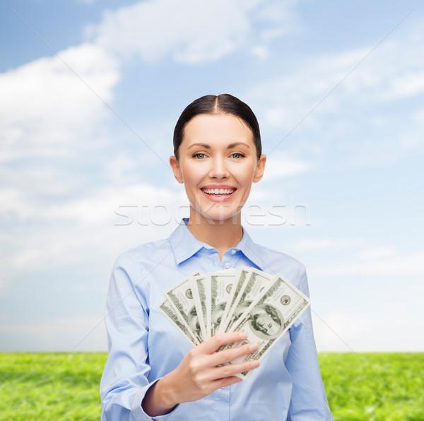 üzletasszony dollár pénz pénz üzlet fiatal Stock fotó © dolgachov