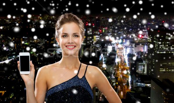 Mujer sonriente vestido de noche tecnología comunicación publicidad Foto stock © dolgachov