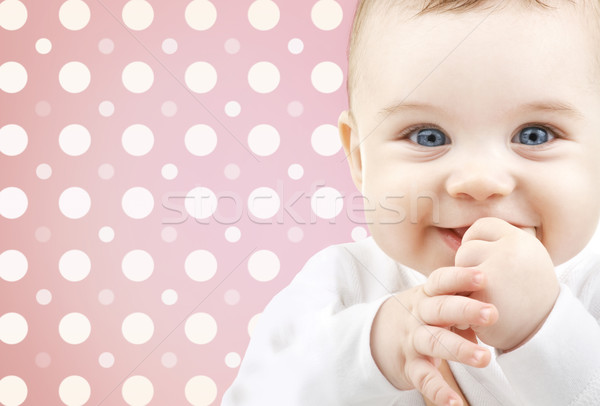 smiling baby girl face over pink polka dots Stock photo © dolgachov