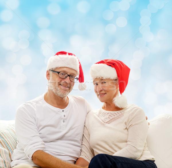 Szczęśliwy starszy para Święty mikołaj pomocnik rodziny Zdjęcia stock © dolgachov