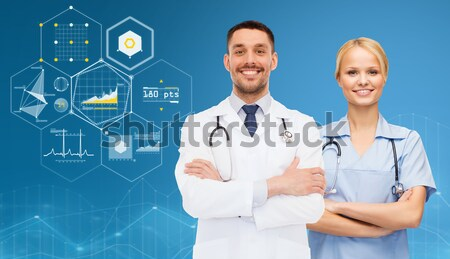 smiling doctor or nurse pointing to pills icon Stock photo © dolgachov